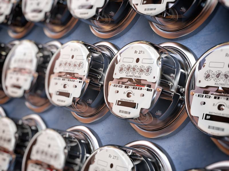 Electric meters in a row measuring power use. Electricity consumption concept.