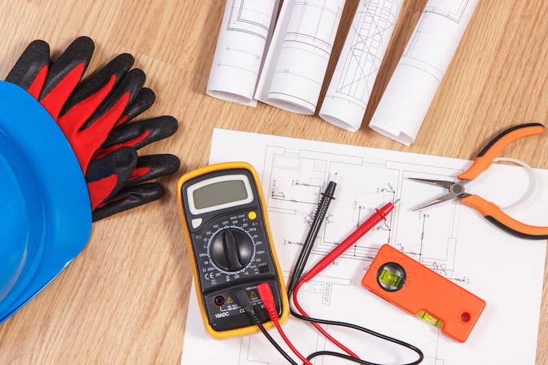 Electrical drawings, multimeter for measurement in electrical installation and accessories for engineer jobs