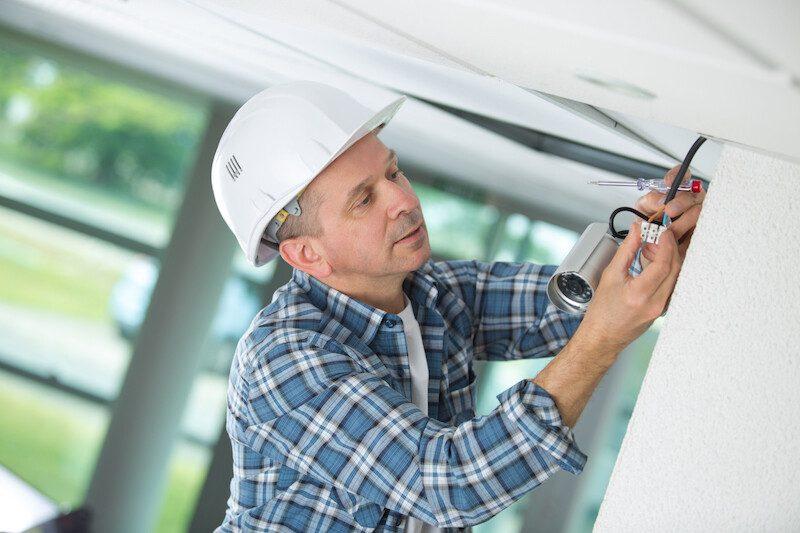 Contractor fitting interior cctv camera