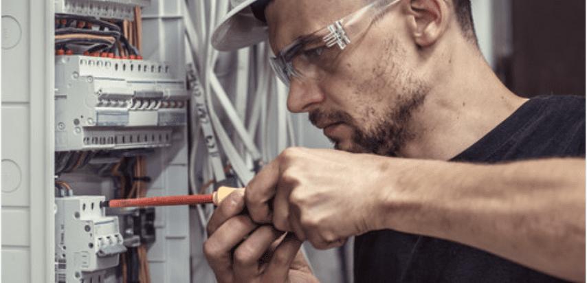 technician working on switchboard