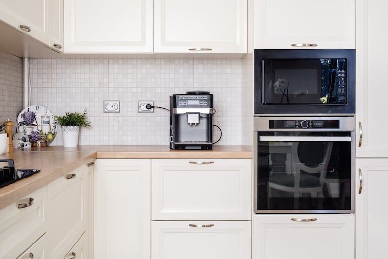 Modern design kitchen with electric appliances and wooden worktop