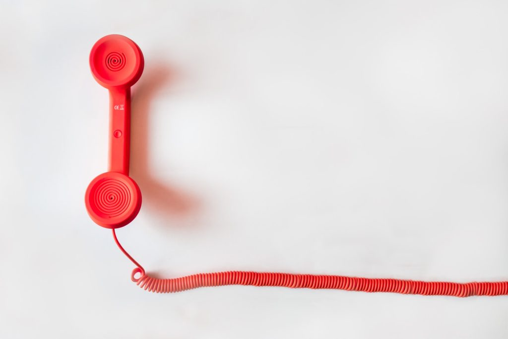 red telephone handle in white background