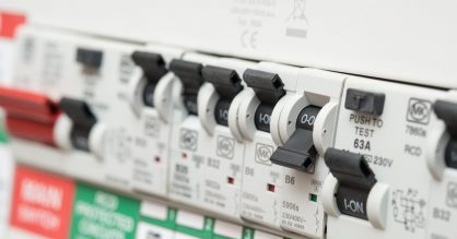 An RCD circuit breaker board displays many switches.